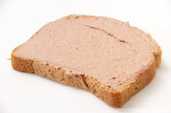 Pate on bread. Over white background Royalty Free Stock Image