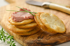 Pate and Crackers. Liver pate with crackers, chives, and thyme Stock Photo