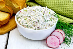 Pate of curd and radish with bread on board Stock Photography