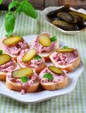 Pate with ham slice of cucumber, parsley, basil and coriander. Stock Image