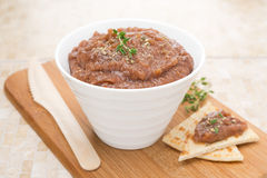 Pate of roasted eggplant and tomatoes on a wooden board Stock Images