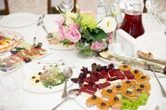 Pate with snacks on a plate. Fresh and delicious food for catering royalty free stock photography
