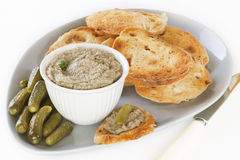 Pate and Toast. Home made chicken liver pate with with toasted sourdough and gherkins, arranged on a platter Stock Photos