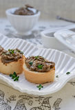 Pate on toast baguette slices. With liver and thyme. Close-up Royalty Free Stock Image