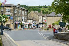 Pateley Bridge main High street. PATELEY BRIDGE, UK - AUGUST 24, 2015: Pateley Bridge market town in Nidderdale North Yorkshire, home of the oldest sweet shop in Royalty Free Stock Photo