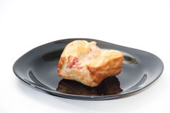 Patella with ham and cheese on the plate Stock Photo