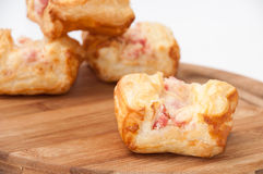 Patella with ham and cheese on the wood Royalty Free Stock Photos