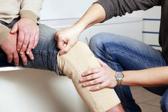 Patella knee support Stock Images