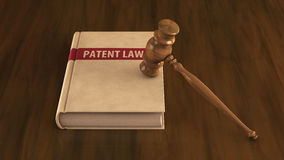 Patent law book with gavel on it. Concept illustration Royalty Free Stock Photography
