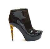 Patent-leather shiny black shoe with high heel Stock Photography