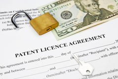 Patent licence agreement. With lock, key and dollar currency royalty free stock images
