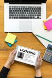 Patent License agreement LICENSING   business man hand working o Royalty Free Stock Photography