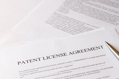Patent license agreement. And pen stock photo