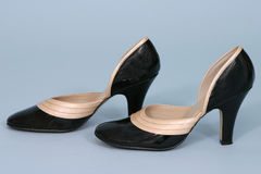 Patent Pumps. Black and tan pumps Stock Images
