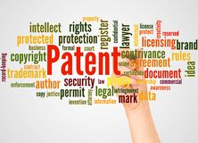 Patent word cloud and hand with marker concept
