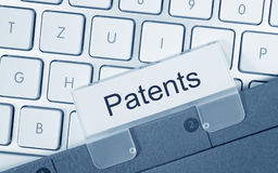 Patents - folder with text on computer keyboard. In the office royalty free stock images