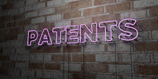 PATENTS - Glowing Neon Sign on stonework wall - 3D rendered royalty free stock illustration Royalty Free Stock Image