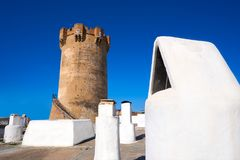 Paterna tower Valencia and chimneys of cave houses. Paterna tower in Valencia and chimneys of underground cave houses Stock Photos