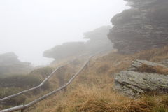 Path. And Rock in fog on top hill by name Vozka ( Cartman ) (Mountains by name Jesenik at Czech republic at Europe Stock Image