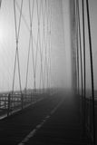 Path. Footpath along the Brooklyn Bridge on a foggy morning royalty free stock image