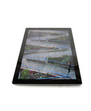 Path Ahead. Business figurine on a tablet screen looking toward a future path Royalty Free Stock Photos
