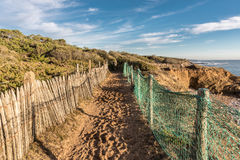 Path along the bay of Cayola Stock Photography