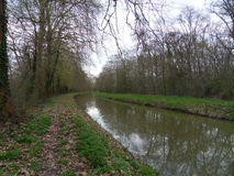 The path along the canal / Beginning of spring Stock Image