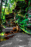 Path along the Cantwell Cliffs. Walking path throughout the Cantwell Cliffs State Park located in the Hocking Hills State Park chain. Logan, Ohio Royalty Free Stock Images