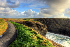 Path along the cliffs of Kilkee in Ireland. Kilkee  is a small coastal town in County Clare, Ireland Stock Images