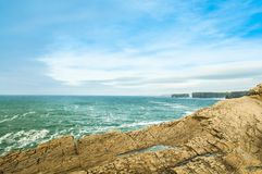 Path along the cliffs of Kilkee in Ireland. Tourist attraction Royalty Free Stock Photo
