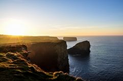 Path along the cliffs of Kilkee in Ireland. Tourist attraction Royalty Free Stock Images