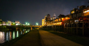 The path along Kamo-gawa River by Pontoncho. Night view of Kamo-gawa River, with backyards of restaurants along Pontoncho area. A traditional nightlife district Royalty Free Stock Photo