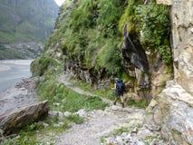 Path along a river. Marsyangdi river valley - Annapurna circuit trek in Nepal royalty free stock photo