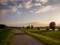 Path along river by sunset Stock Image