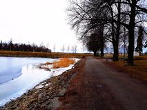 Path Along the River. A walkway along the frozen river Royalty Free Stock Photography