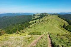 Path through the amazing spring mountain ridge Royalty Free Stock Photo