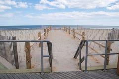 Path on beach to ocean stock photos