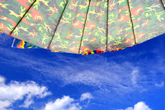 Path of beach umbrella with sky. Path of beach umbrella with blue sky and cloud in hard sun light Stock Images