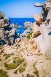 Path betweeen bizarre granite rock formations in Capo Testa, Sardinia, Italy Stock Image
