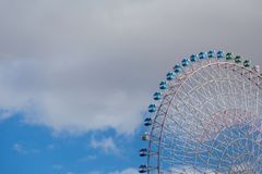 Path of big attraction funfair ferris wheel. With blue sky background Stock Photos