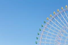 Path of big funfair ferris wheel against clear blue sky Stock Photos