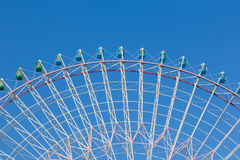 Path of big funfair festival ferris wheel. With clear blue sky background Royalty Free Stock Image