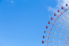 Path of big funfair festival ferris wheel. Playground with blue sky background Royalty Free Stock Photos