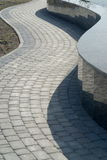 Path and border. Zigzags of sidewalk and border. Sea waves Stock Photography