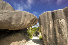 Path between boulders rocks La Digue island Seychelles, vacation background. Seychelles is the most beautiful tropical islands of the world's in the Indian Ocean Stock Photography