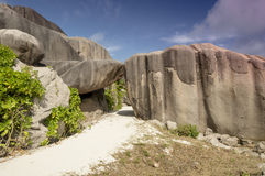 Path between boulders rocks La Digue island Seychelles, vacation background. Seychelles is the most beautiful tropical islands of the world's in the Indian Ocean Royalty Free Stock Photography