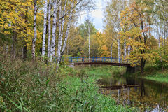 The path through the bridge in a beautiful country Park on a Sunny autumn day Royalty Free Stock Image
