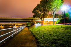 Path and bridges along the Potomac River at night, in Washington Stock Image