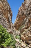 Path Caminito del rey along steep cliffs, rocks and mountain river in Spain stock photos