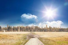 Path with cityscape on horizon Royalty Free Stock Photo